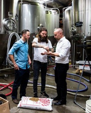 Tom Nockolds (right) discusses an upcoming community solar installation at Young Henry's Brewery in Newtown. (Image courtesy of smh.com.au)